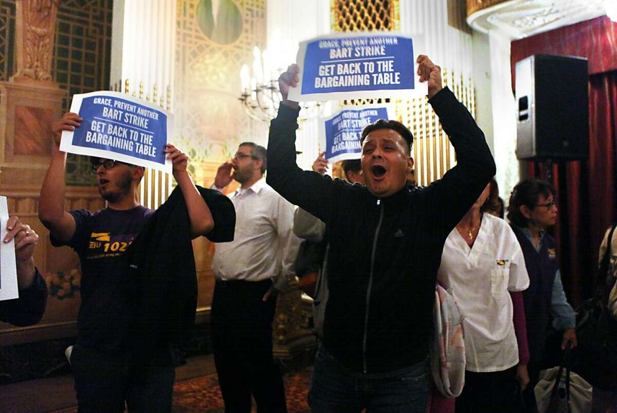 BART union members protest as BART general manager Grace Crunican gives a presentation at the 2013 APTA Sustainability and Public Transportation workshop at the Westin St. Francis Hotel in San Francisco, Calif., onMonday, July 29, 2013.