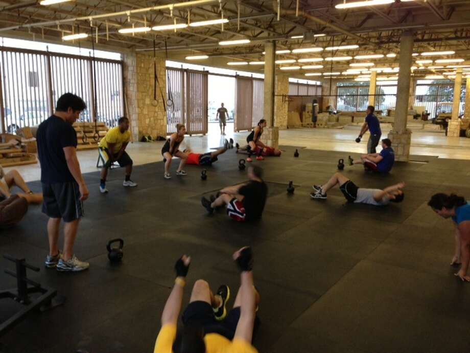 Rackspace offers free Crossfit classes four times a day in the former Montgomery Wards garden section of their 1 million square-foot facility, the former site of the Windsor Park Mall. Photo: Sarah Tressler/San Antonio Express-News