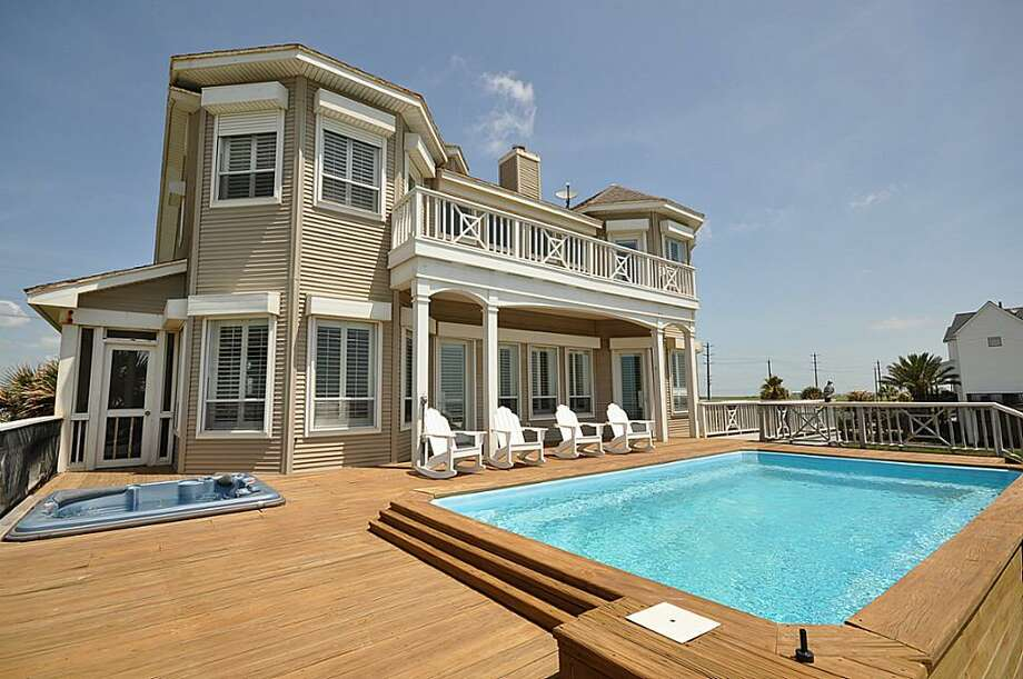 Every room in this West End home features a water view of either the beach or the bay, but this deck with both pool and hot tub is also a nice addition for water lovers.