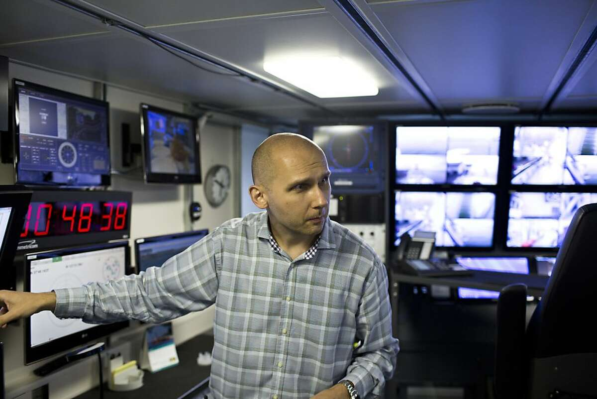 Dr. Victor Zykov, director of research on the Schmidt Ocean Institute's R/V Falkor, is seen in the control room of the ship that's filled with surveillance monitors and other data the team collects to analyze while docked at the Exploratorium in San Francisco, Calif., Monday, July 30, 2013.