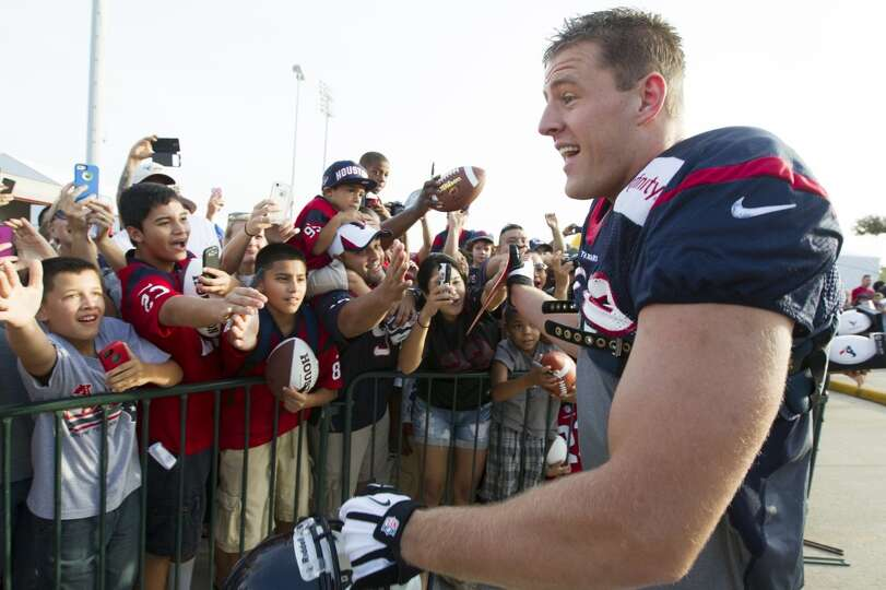 Fans welcome defensive end J. J. Watt as he enters the field at training camp on Tuesday.