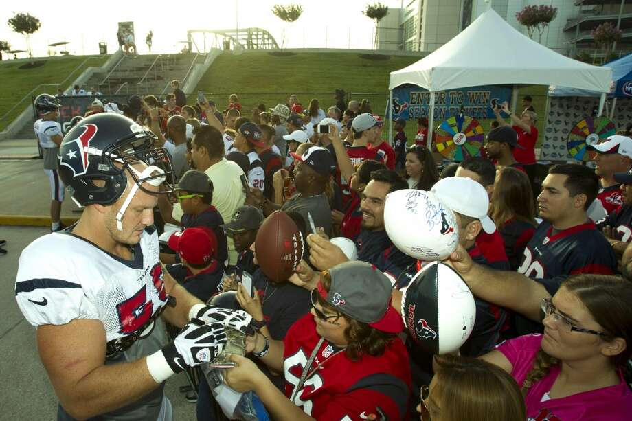 Center Chris Myers (55) signs autographs on his way to practice. Photo: Brett Coomer, Chronicle