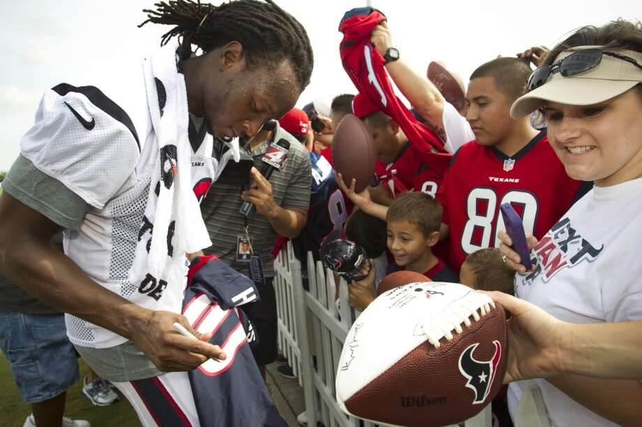 Wide receiver DeAndre Hopkins, left, signs autographs after practice. Photo: Brett Coomer, Chronicle