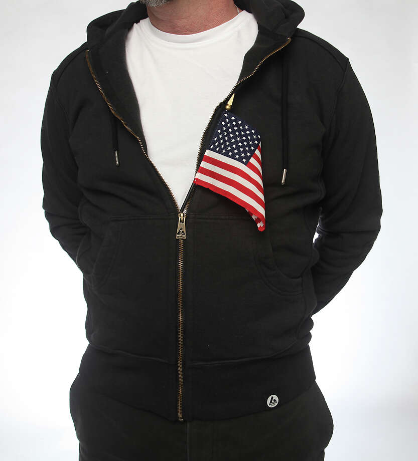 Express-News book editor Steve Bennett wears a heavyweight hoodie from American Giant. The hoodie is made in the United States and sells for $89. Photo: Juanito Garza, San Antonio Express-News / San Antonio Express-News