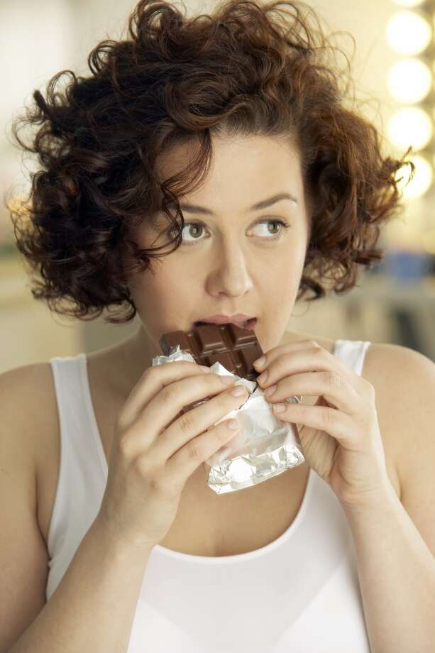 More women report overeating or eating unhealthy foods when they are stressed out. (49 percent vs. 30 percent of men) Photo: Peter Teller, Getty Images