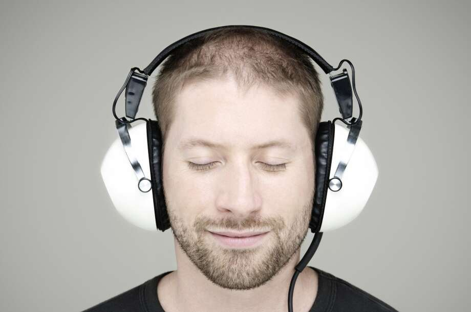 More men (52 percent) say listening to their favorite music helps them unwind. But a large portion of women (47 percent) agree. Photo: John Rensten, Getty Images