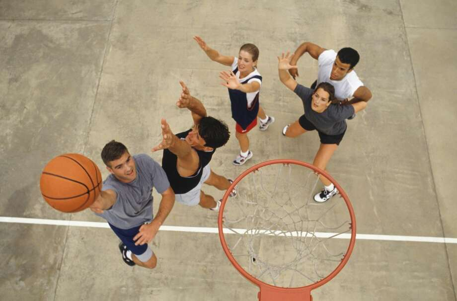 Men are more likely than women to use sports to banish stress. Only 4 percent of women say sports help them relax, compared to 16 percent of men. Photo: Photodisc, Getty Images