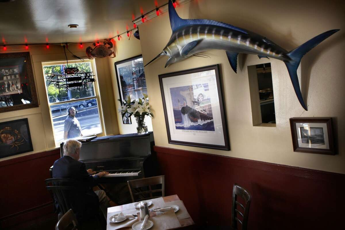 This week's installment of the Chronicle's ongoing Port Series profiles Pier 23 Cafe. As Jon Bonné points out in his piece, Pier 23 Cafe finds itself in a strange time, with its extensive dive history on one side, and Larry Ellison's mega-yachts on the other side. Above: Terrill