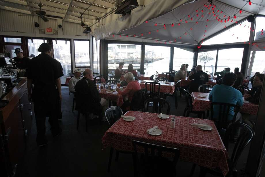 Guests eat at Pier 23 Cafe Photo: Jessica Olthof, The Chronicle