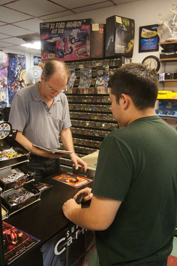 """Third Planet Sci-Fi Super Store owner TJ Johnson's German grandparents used comics to learn English, and he became hooked at an early age. """"I started collecting, and it got out of hand,"""" he said. """"I either had to sell or start a business."""" Photo: R. Clayton McKee, Freelance / © R. Clayton McKee"""