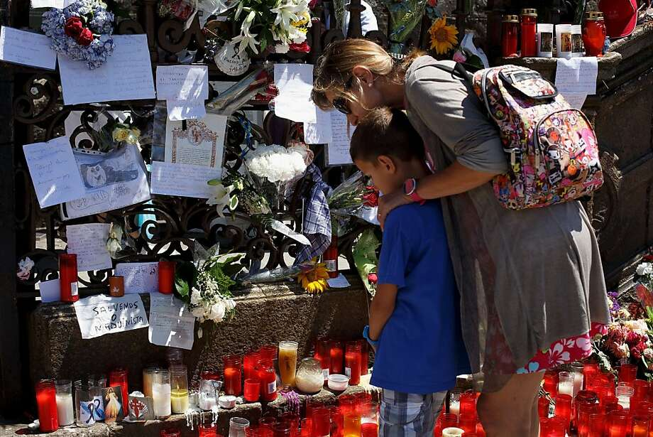 Flowers and candles are left in memory of crash victims. The driver of the train was on the phone and speeding at the time of the derailment. Photo: Pablo Blazquez Dominguez, Getty Images