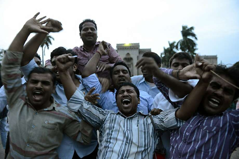Osmania University students celebrate after the announcement of the separate Indian state of Telangana in Hyderabad on July 30, 2013. India's ruling Congress party approved a resolution July 30 to create a new state in the southeast amid fears the decision could spark violence in the region which includes IT hub Hyderabad. AFP PHOTO/Noah SEELAMNOAH SEELAM/AFP/Getty Images Photo: Noah Seelam, AFP/Getty Images