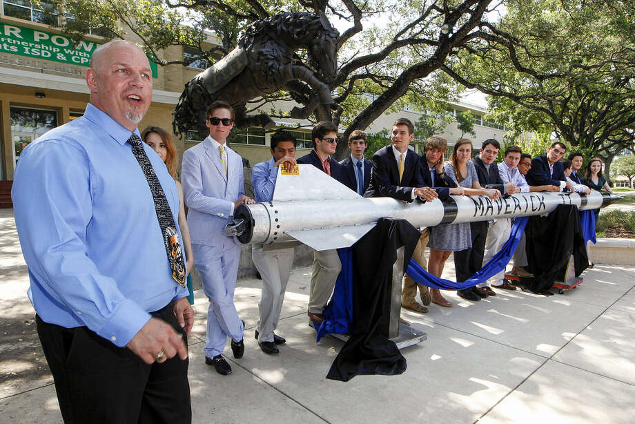 Alamo Heights High School aerospace engineering teacher Colin Lang (left) and his students unveil their newest rocket July 25 on campus before departing for the White Sands (N.M.) Missile Range. There on Tuesday the U.S. Army launched the custom-designed and built rocket. Photo: Marvin Pfeiffer / San Antonio Express-News