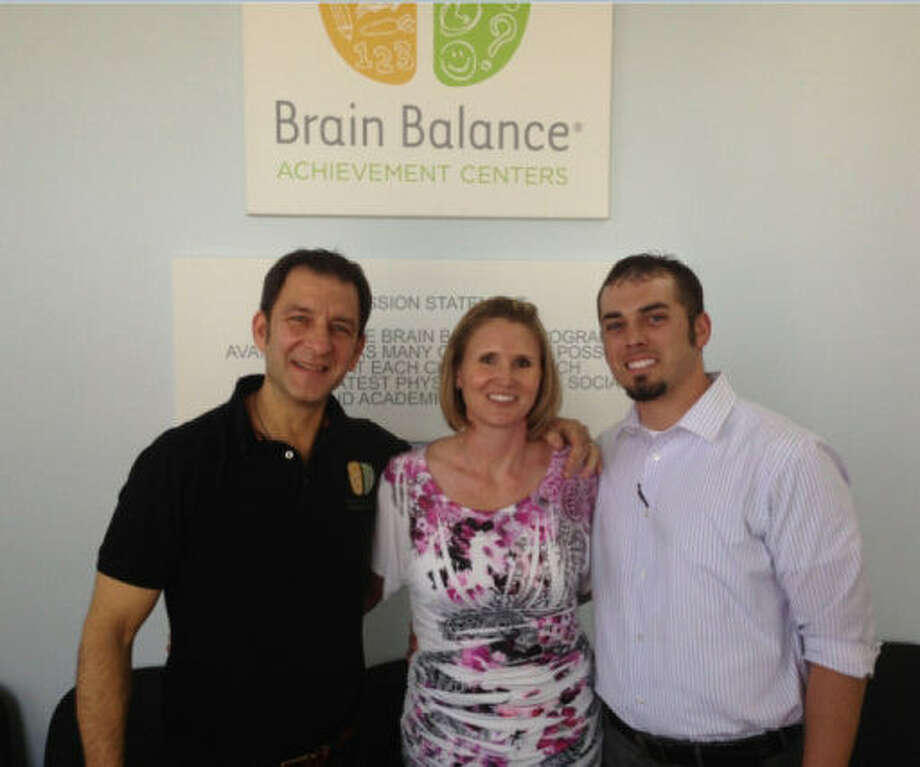 Dr. Robert Melillo, founder of Brain Balance Achievement Centers (left), poses with Amanda and Zach Petter, owners of the newly opened BBAC local franchise near Stone Oak. Photo: Courtesy Photo