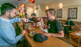 Owner Bodhi Freedom pours wine for a customer at 20 Spot in San Francisco, Calif., Saturday, July 27th, 2013.