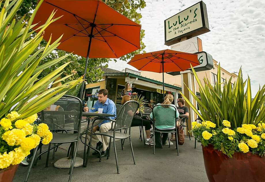 Diners enjoy lunch al fresco at Lulu's, which has the charm of a neighborhood favorite. Photo: John Storey, Special To The Chronicle