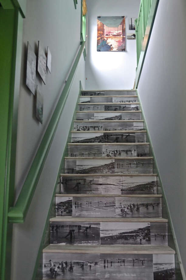Creative decoupage makes this stairwell unique.  Photo: Brian Paquette Interiors