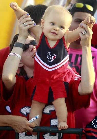 Ten-month-old Kellee Bishop shows off her Texan pride as she is held up by her mother Clare.
