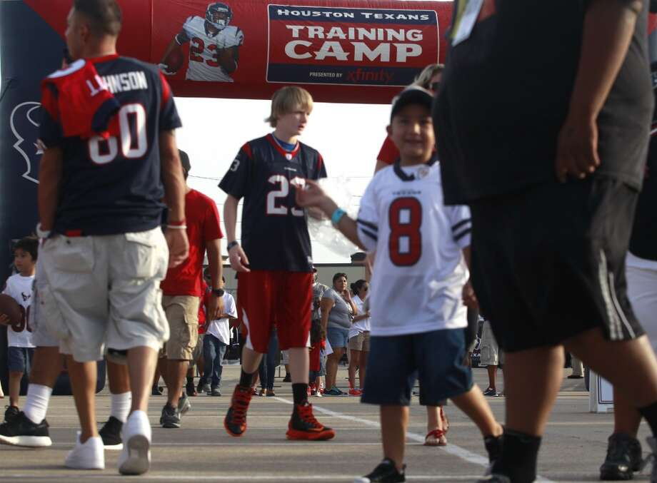 Fans walk the grounds. Photo: J. Patric Schneider, For The Chronicle