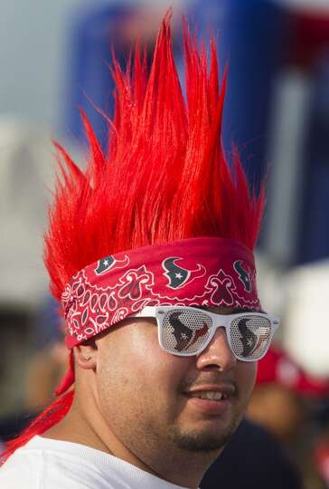 Adolfo Velasquez shows off his Texan pride with his battle red hair and glasses.