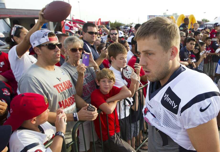 Case Keenum visits with fans before practice. Photo: J. Patric Schneider, For The Chronicle