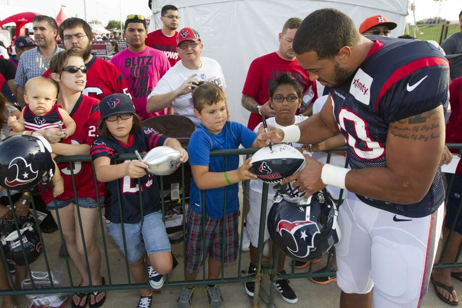 Cameron Collins signs autographs. Photo: J. Patric Schneider, For The Chronicle