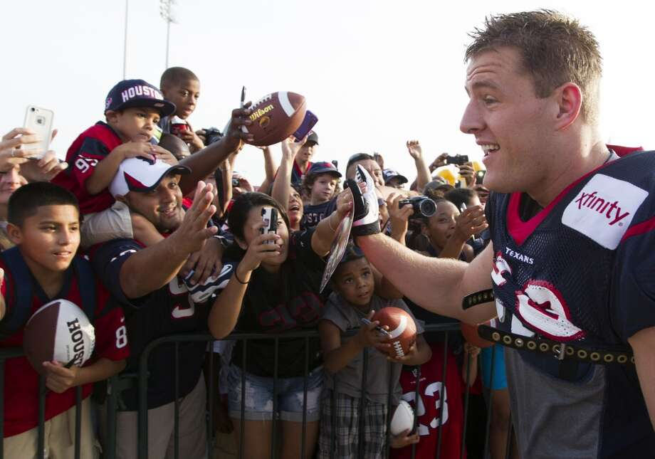 Fans welcome defensive end J. J. Watt as he enters the field. Photo: J. Patric Schneider, For The Chronicle