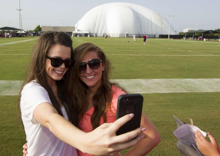 Kerri Carpenter and her friend Rachel Crihfield take a picture on the practice field. Photo: J. Patric Schneider, For The Chronicle