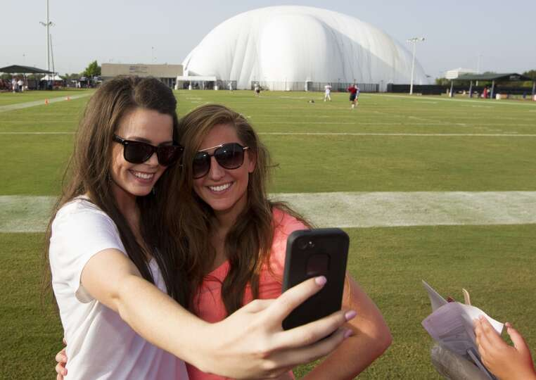 Kerri Carpenter and her friend Rachel Crihfield take a picture on the practice field.