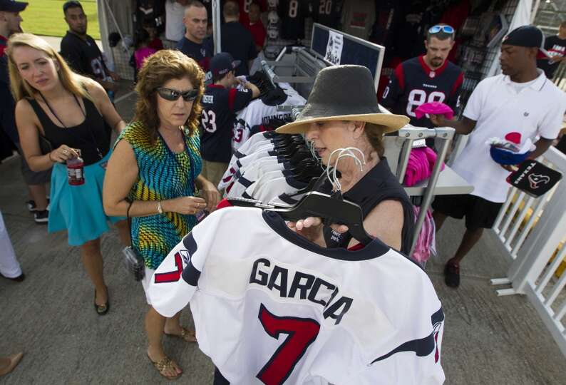 Marlene Cole helps fans pick out Texans attire.
