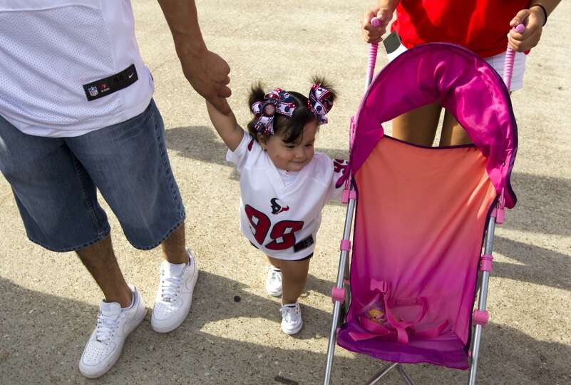 Aubrey Castillo, 1, walks the grounds with her father Nicolas and mother Leslie Guevara