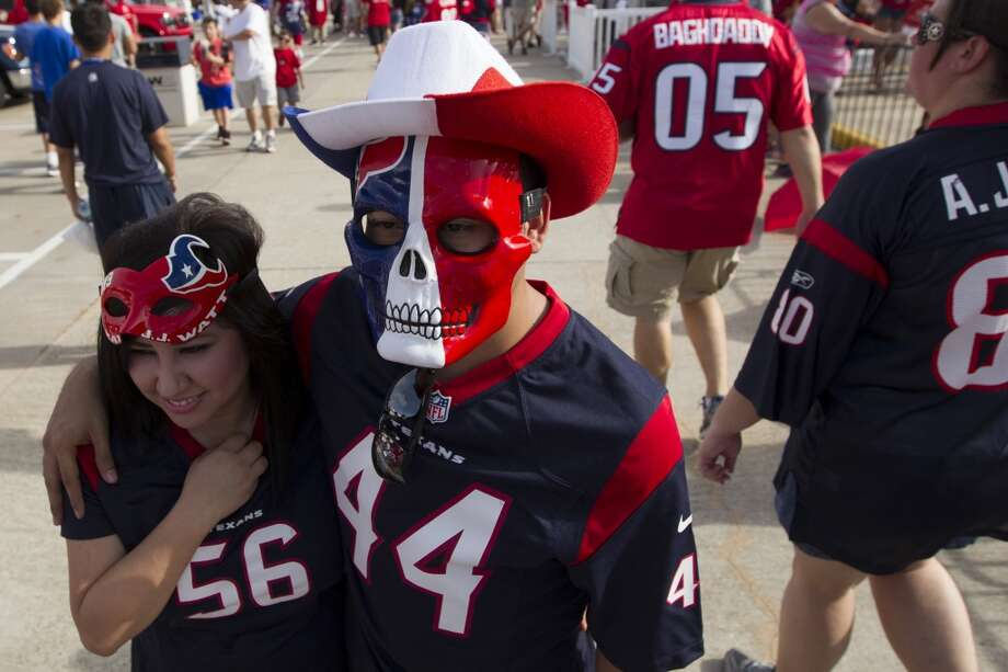 Fans Carolina Montano and Jonathan Garza walk the grounds. Photo: J. Patric Schneider, For The Chronicle
