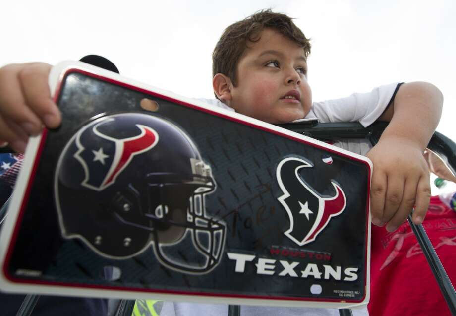 Jace Garza, 6, shows off his Texan pride. Photo: J. Patric Schneider, For The Chronicle