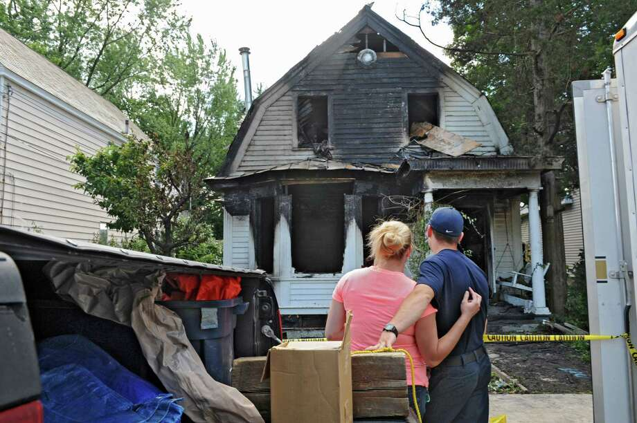 Walter Maul looks with disbelief at his father's fire damaged home at 317 Mohawk Ave. Tuesday afternoon, July 30, 2013 in Scotia, N.Y. The fire started just after 5:30 a.m. Tuesday morning. (Lori Van Buren / Times Union) Photo: Lori Van Buren / 10023353A