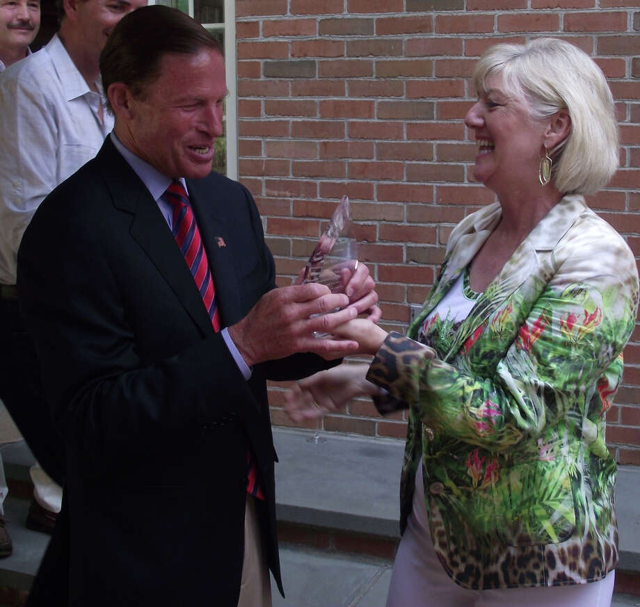 U.S. Sen. Richard Blumenthal received the first Beauty with a Cause Award from Cathy Kangas on July 21 in recognition of his work on behalf of animals. Photo: Contributed Photo