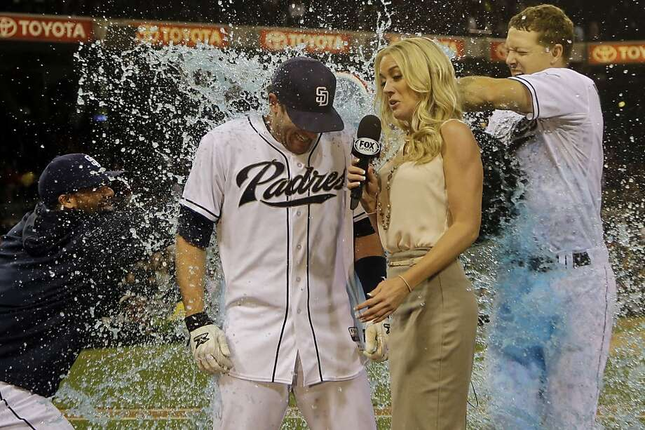 Well-hydrated hero:Padres Nick Hundley (right) and Rene Rivera give teammate Chris 