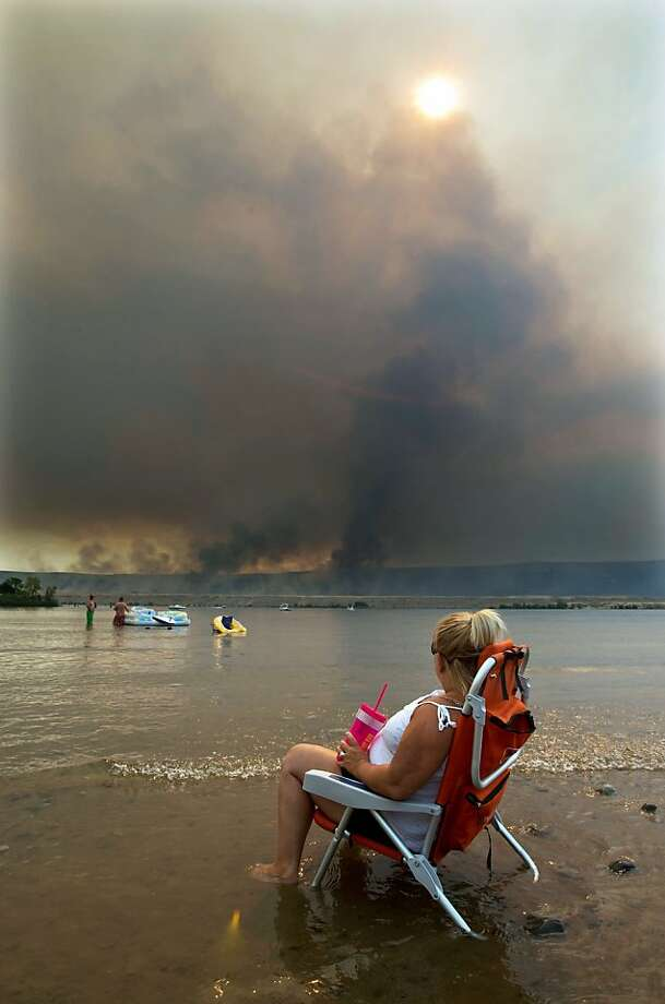 This is the life: Jody Erickson relaxes with a cold drink as she watches the Colockum 