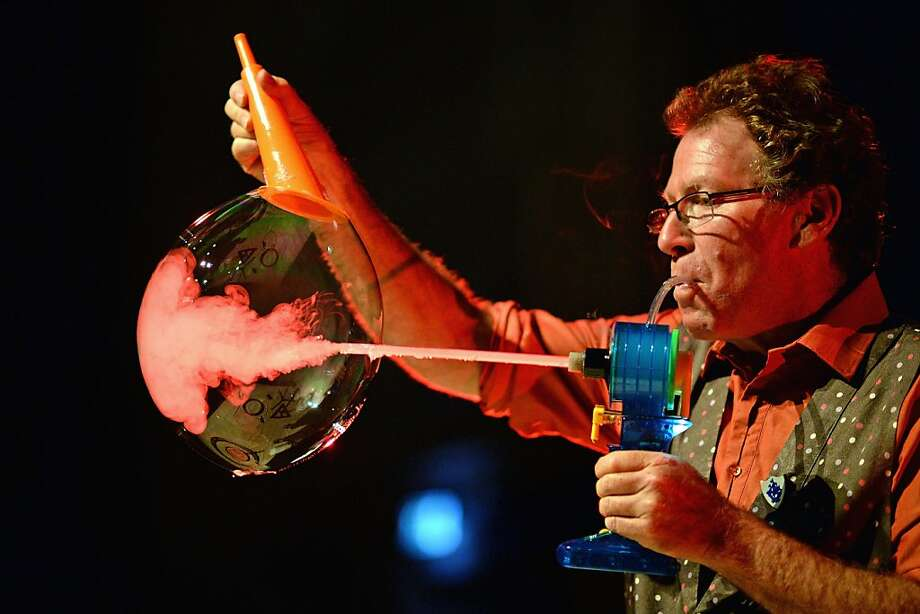 """Blow globe:Louis Pearl, """"The Amazing Bubble Man,"""" rehearses for a performance at the Assembly Rooms  in Edinburgh, Scotland. He'll be featured at the Edinburgh Fringe Festival, one of the largest arts festivals in the world. Photo: Jeff J Mitchell, Getty Images"""