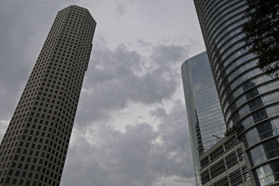 They walk around downtown looking up and taking photos.   Our buildings are best seen from far away. Photo: Thomas B. Shea, For The Houston Chronicle