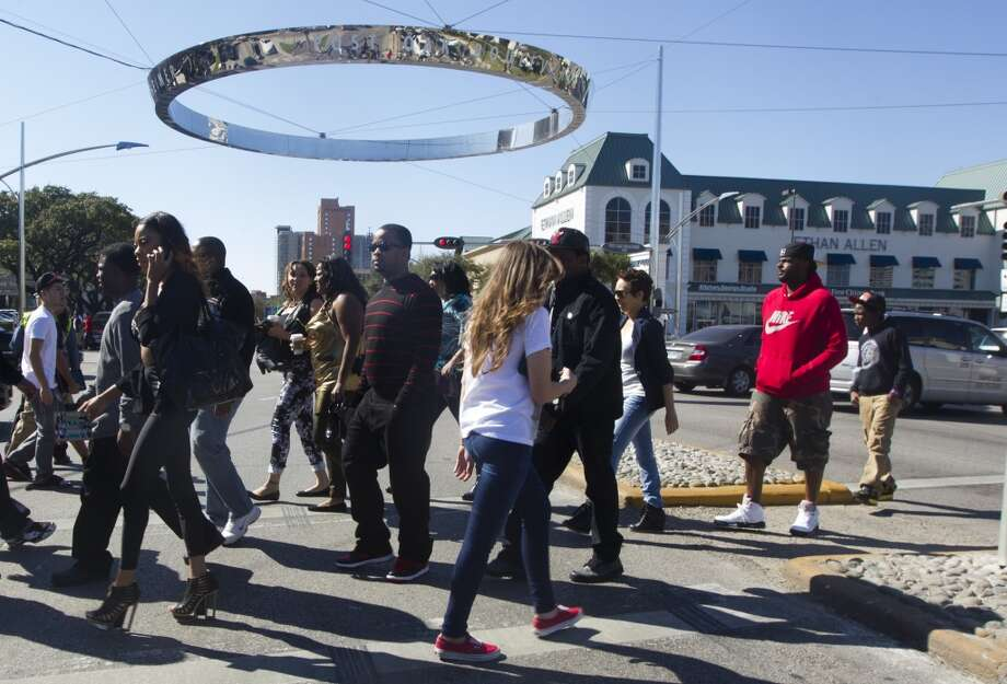 They try to cross Westheimer on foot.   Silly tourists. Photo: J. Patric Schneider, For The Houston Chronicle