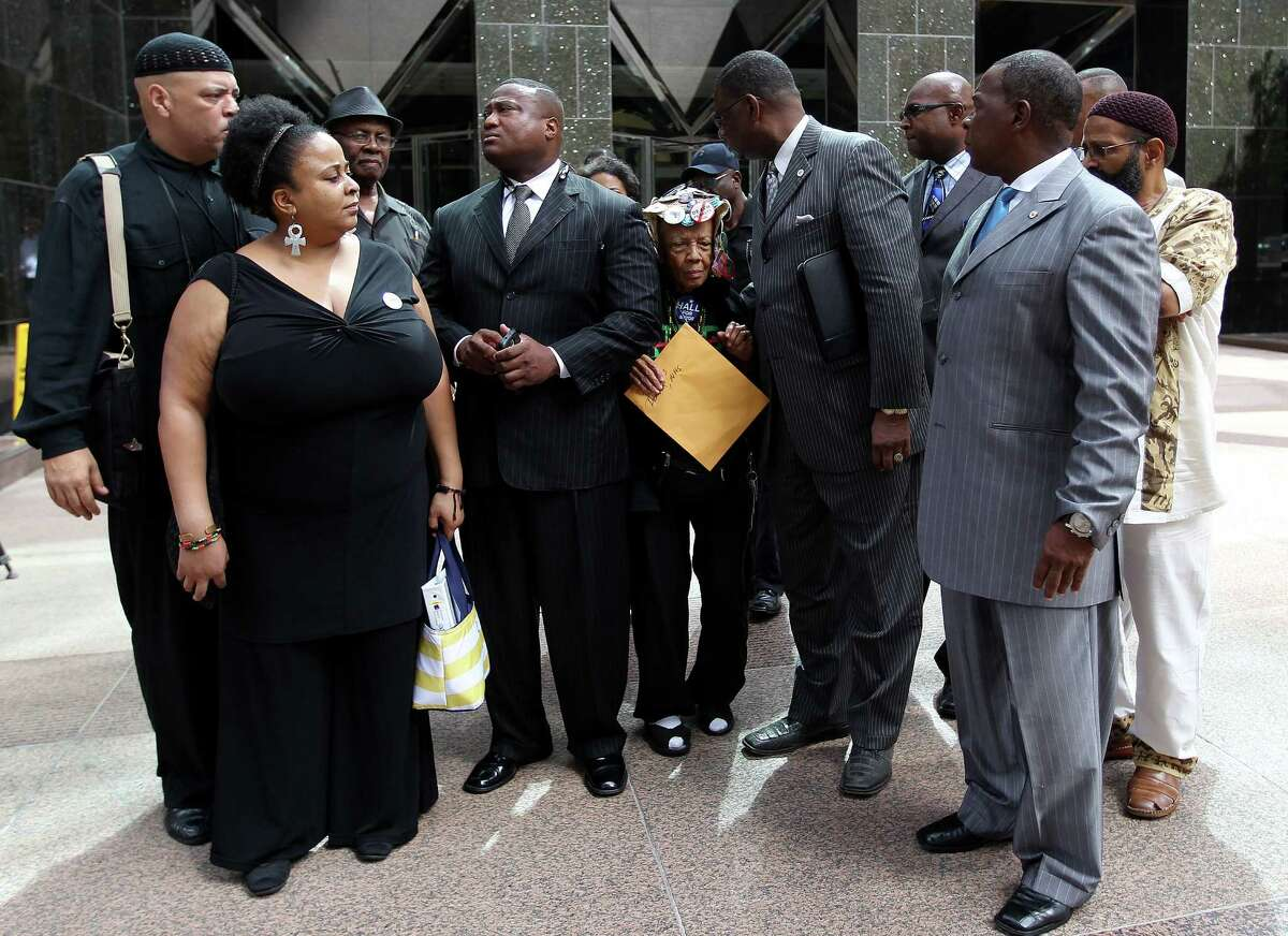 Jean Wilkins Dember, with New Day Enterprises, tries to squeeze into the front row as Quanell X prepares to speak to the media after their meeting with Dept. of Justice Official Kenneth Madgison at the Wells Fargo Building, Tuesday, July 30, 2013, in Houston. ( Karen Warren / Houston Chronicle )