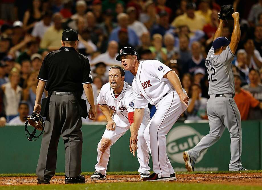 We wuz robbed: Daniel Nava (left) and Brian Butterfield plead their case after umpire Jerry Meals called Nava out at the plate in the eighth inning of the Red Sox-Rays game at Fenway. Nava's run would have tied the game. Replay showed that Meals missed the call. Photo: Jim Rogash, Getty Images