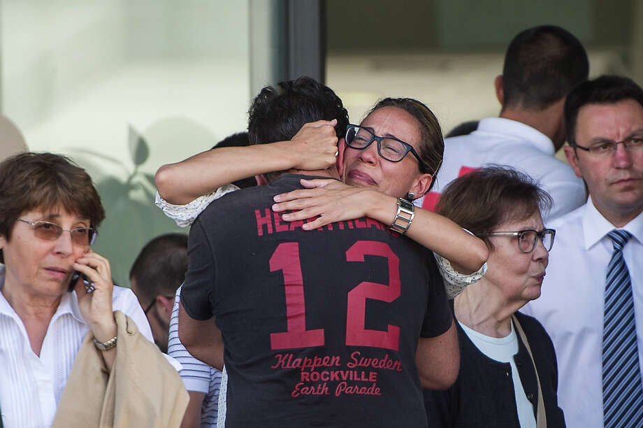 Relatives of passengers involved in the train crash wait for news at the Cersia Building on July 25, 2013 in Santiago de Compostela, Spain. The crash occurred as the train approached the north-western Spanish city of Santiago de Compostela at 8.40pm on July 24th,  at least 77 people have died and a further 131 reported injured. The crash occured on the eve of the Santiago de Compostela Festivities. Photo: David Ramos, Getty Images / 2013 Getty Images