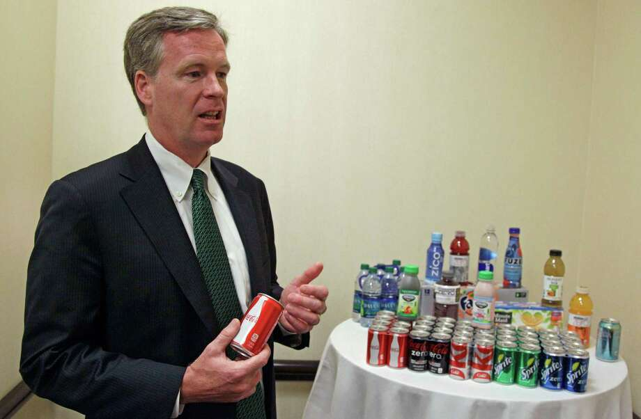 Steve Cahillane, president and CEO of Coca-Cola Refreshments, Inc., speaks during an interview with the Associated Press Thursday, June 7, 2012, while attending the Clinton Global Initiative America gathering in Chicago. Cahillane said that New York Mayor Michael Bloomberg's proposal to ban the sale of large sodas and other sugary drinks unfairly singles out an industry. He says the measure is overly simplistic and would do nothing to address the complex problems of obesity and other health issues. (AP Photo/M. Spencer Green) Photo: M. Spencer Green
