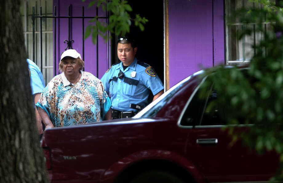 "A woman cooperates with police as they investigate a scene where four individuals were held captive in the 8600 block of White Castle in Houston, Friday, July 19, 2013, in Houston. Police found four men held against their will in the home in deplorable conditions after they responded to a 911 call that brought police to a north Houston home described as a ""dungeon"". (Cody Duty / Houston Chronicle) Photo: Cody Duty, Staff / © 2013 Houston Chronicle"