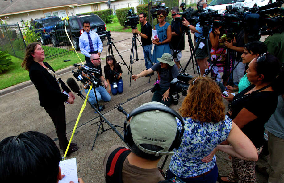 """HPD spokesperson Jodi Silva answers questions regarding the involvement of a scene where four individuals were held captive in the 8600 block of White Castle in Houston, Friday, July 19, 2013, in Houston. Police found four men held against their will in the home in deplorable conditions after they responded to a 911 call that brought police to a north Houston home described as a """"dungeon"""". (Cody Duty / Houston Chronicle) Photo: Cody Duty, Staff / © 2013 Houston Chronicle"""