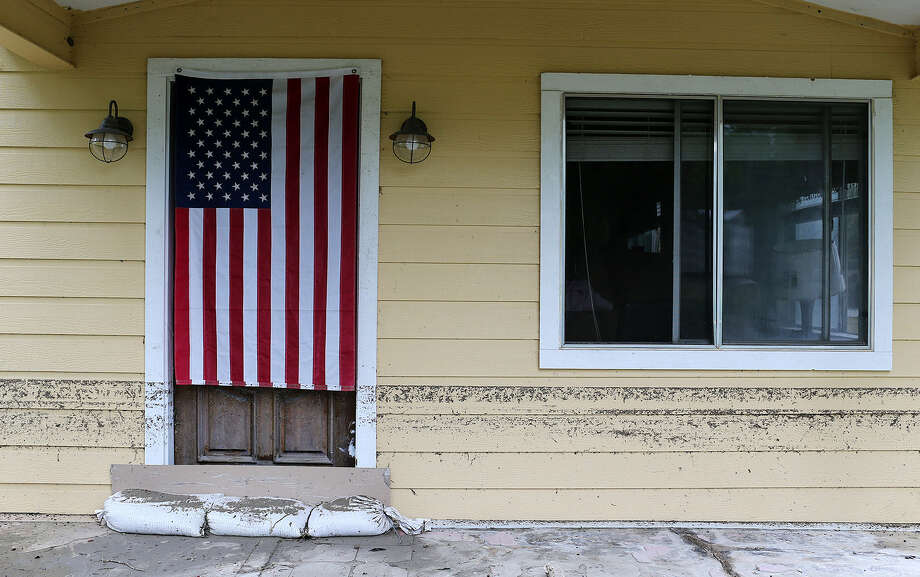 A water line registered the height of flood waters on a house along Mission Road on May 26. An E-N reader wonders what the expense will be to repair damage caused by flooding in May, and how it will affect homeowners and taxpayers. Photo: Jerry Lara / San Antonio Express-News