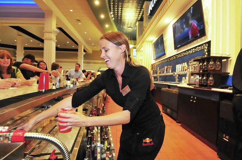 Brittany Rollins mixes drinks in the Agora Bar at the Santikos Palladium, 7301 Grand Parkway. Photo: Â Tony Bullard 2013, Freelance Photographer / © Tony Bullard & the Houston Chronicle