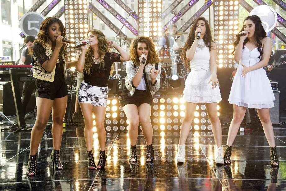"Members of Fifth Harmony — Normani Hamilton (from left), San Antonio native Ally Brooke, Dinah Jane Hansen, Camila Cabello and Lauren Jauregui — met on ""The X Factor."" Photo: Invision / Associated Press"