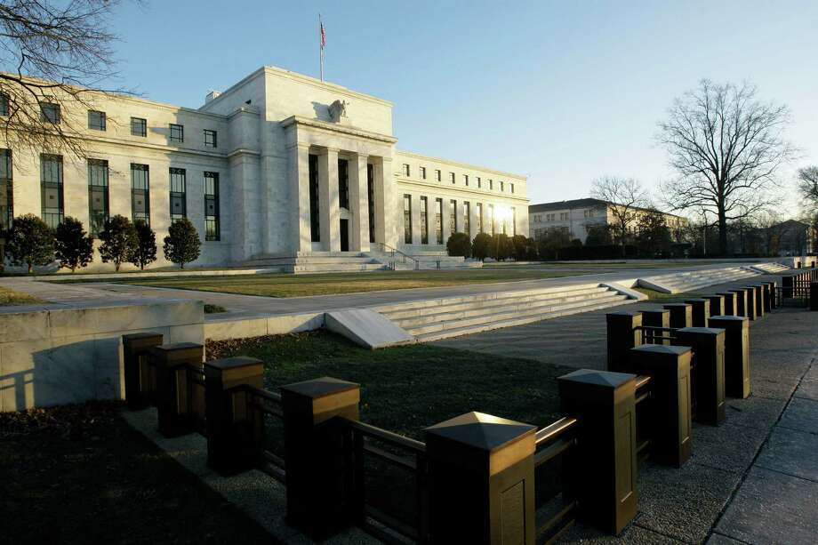 FILE - This Jab. 14, 2010 file photo shows the Federal Reserve Building in Washington. When the Federal Reserve offers its latest word on interest rates this week, few think it will telegraph the one thing investors have been most eager to know: When it will slow its bond purchases, which have kept long-term borrowing rates low.  (AP Photo/Alex Brandon, File) ORG XMIT: WX102 Photo: Alex Brandon / AP